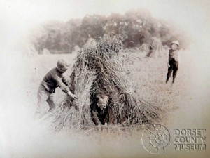 Children playing in Straw Bundles, Winterborne Monkton - © Dorset County Museum