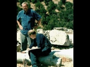 Tony Harrison, important modern poet, with Jim Potts, in Delphi, 2003. Searching for the fading initials on a fallen column, of Lord Byron and Hobhouse - Image Credit: Jim Potts © 2018
