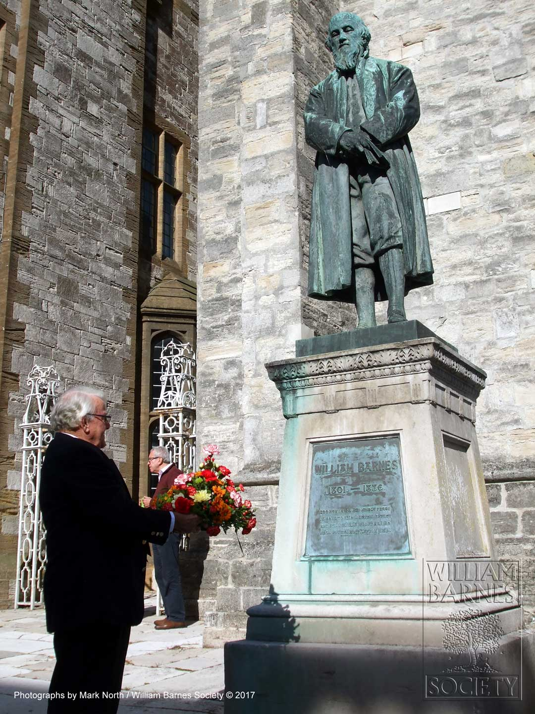 The wreath was laid at the foot of William Barnes statue by David Downton