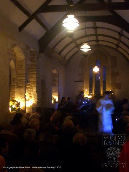 Singing Christmas Carols in Whitcombe Church