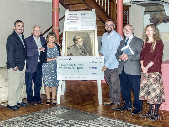 Marion Tait, Honorary Curator of the William Barnes Collection presenting a cheque for £3000 to Jon Murden, Director of Dorset County Museum.